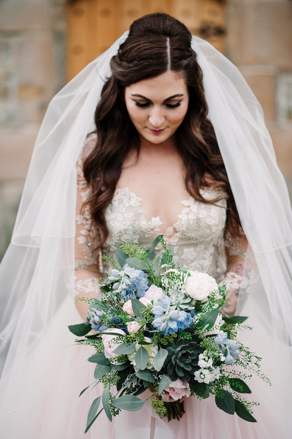 Detailed photo of wedding dress and flowers. Ribble Valley wedding
