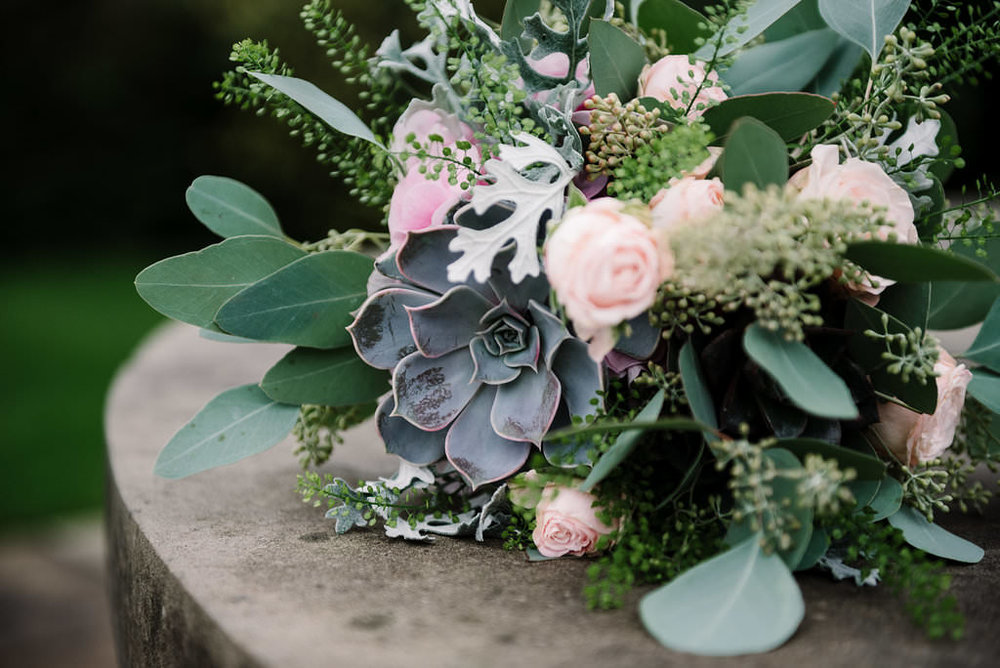 Close up of brides bouquet with succulents. Modern wedding photography Lancashire