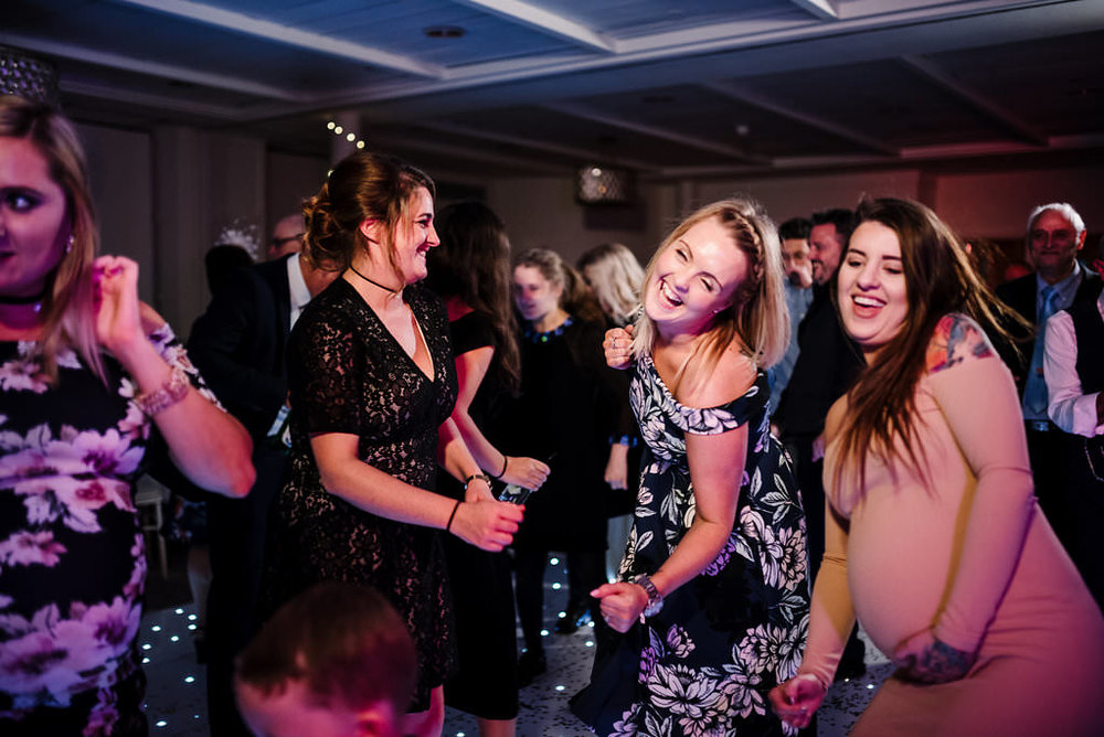 Fun photo of guest dancing at Stanley House. Ribble Valley wedding photography