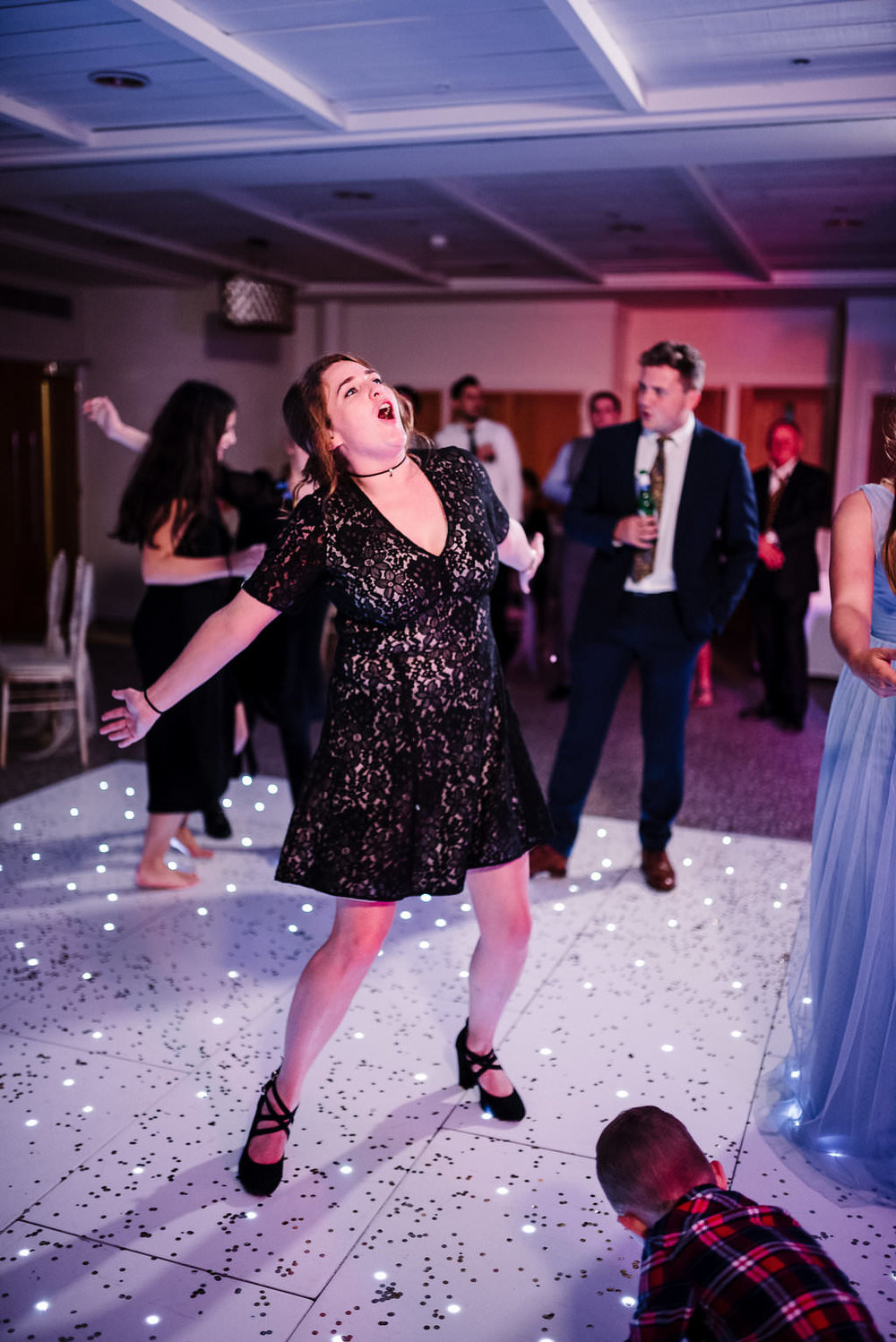 Fun photo of guest dancing. Stanley house wedding photography