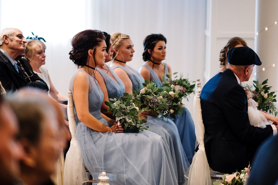 Natural photograph of the Bridesmaids during wedding service