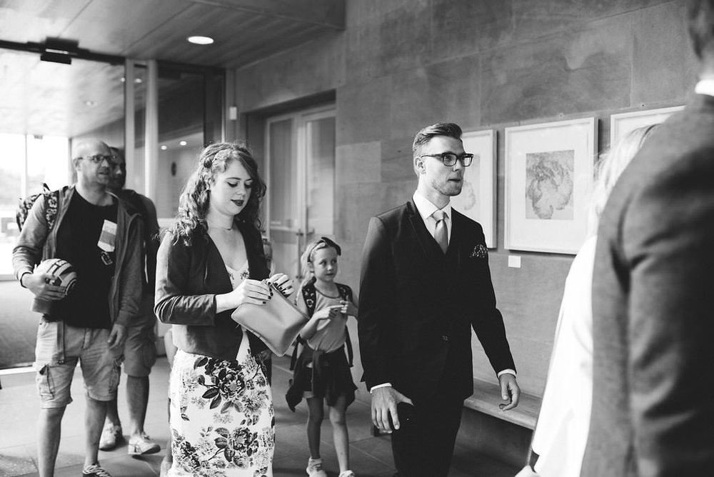 Black and white photo of guests arriving