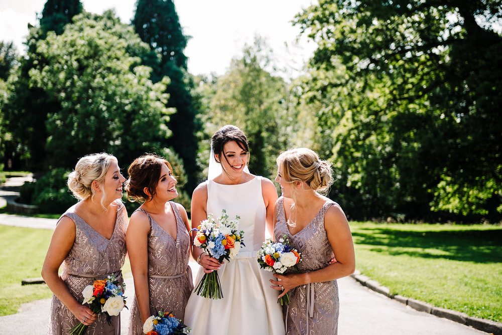 Bride with bridesmaids at Rivington Hall Barn wedding in Bolton, Lancashire.