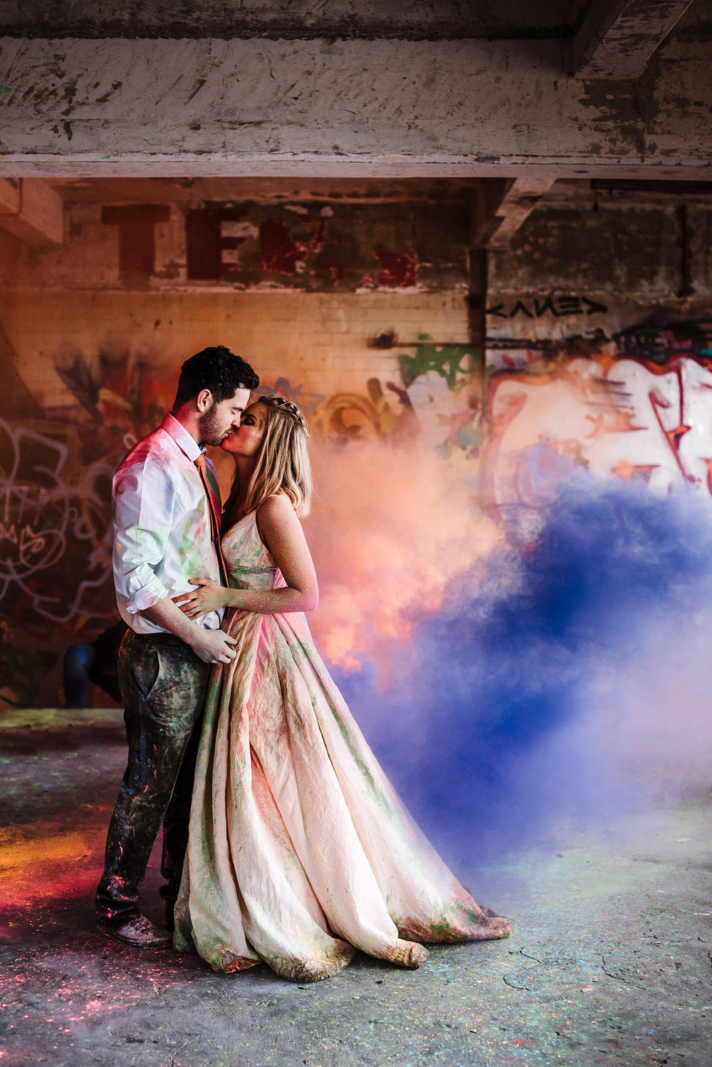 Bride and groom portrait with colourful smoke bombs. Lancashire wedding photography.