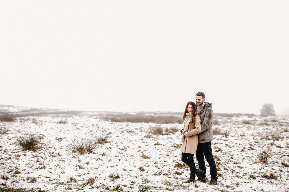 Snowy scene in Bolton Lancashire. Couple standing together