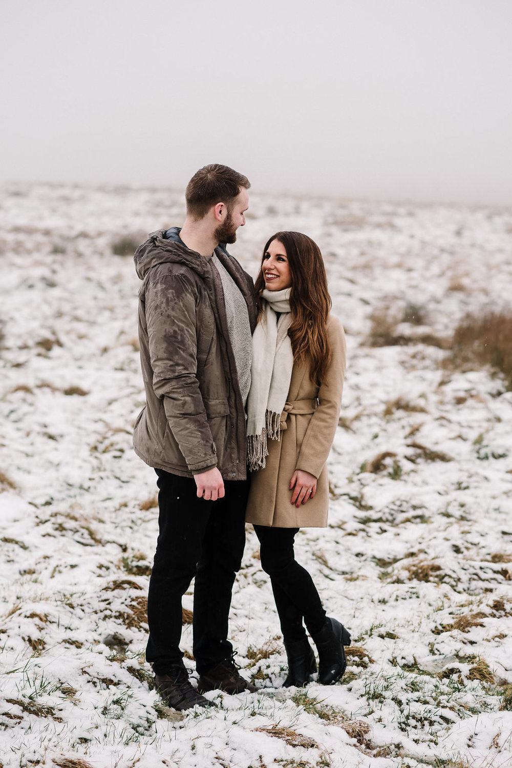 Relaxed shot of couple standing together in the snow
