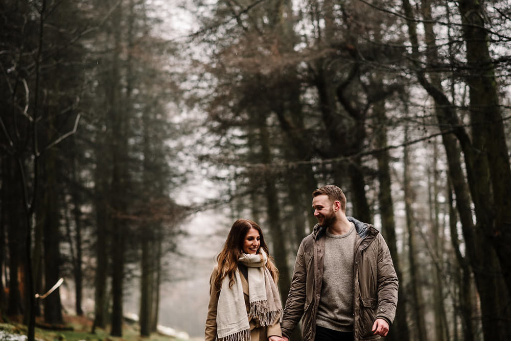Relaxed photo of couple together in the woods