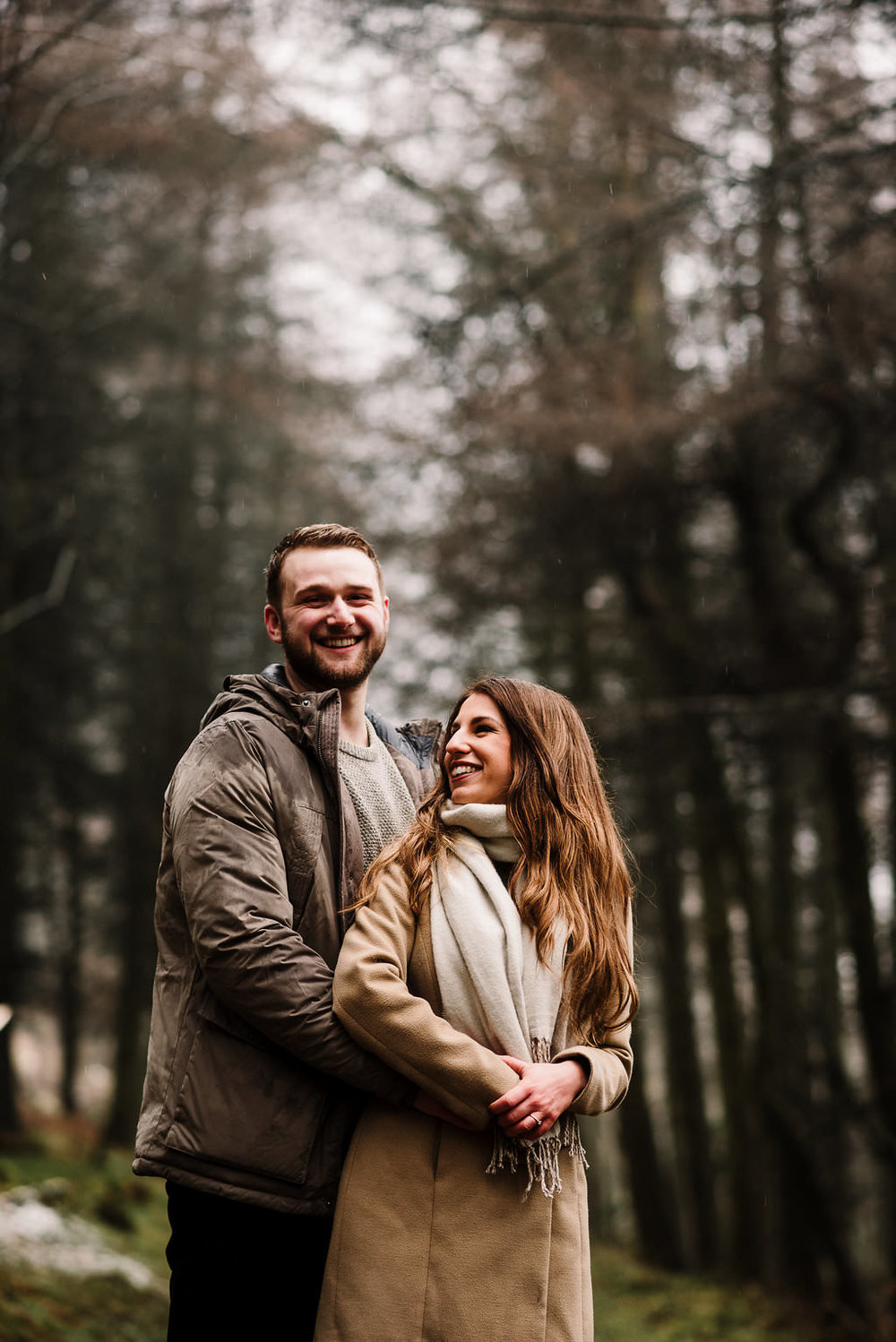 Natural portrait of couple together in the woods laughing. Engagement photography Bolton, Lancashire.