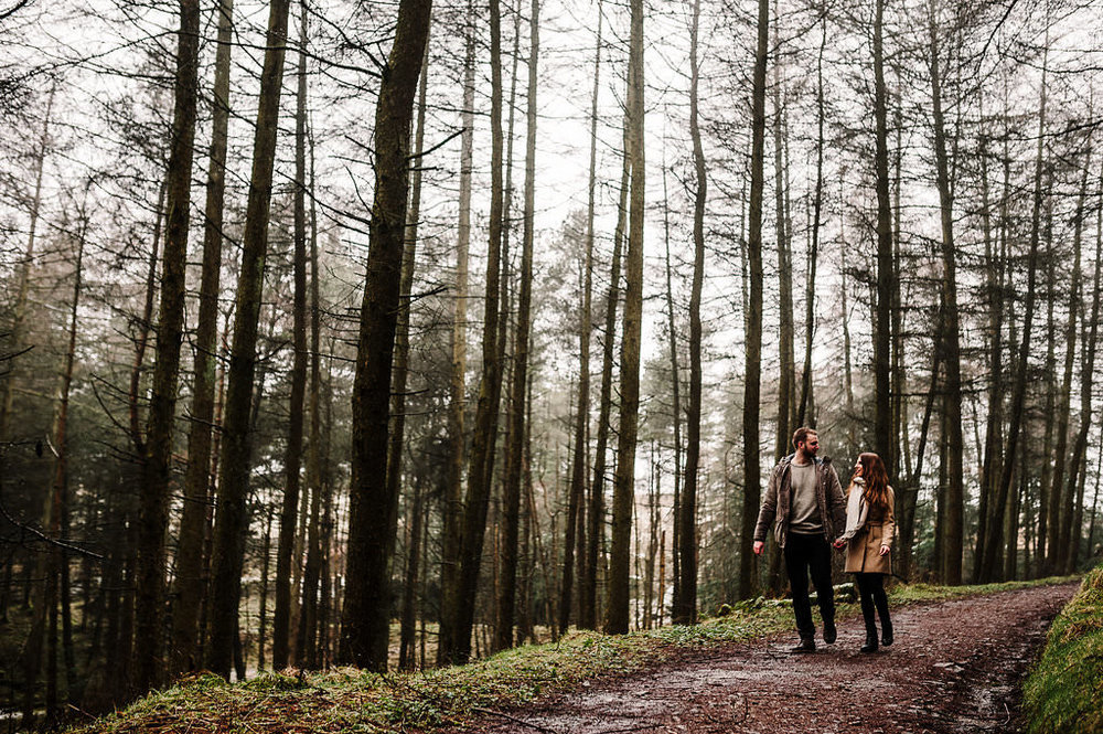 Couple walking in woods together. Bolton lifestyle photography