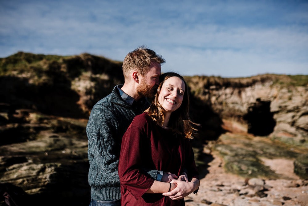 Natural, relaxed portrait whist hugging. West Kirby engagement photography