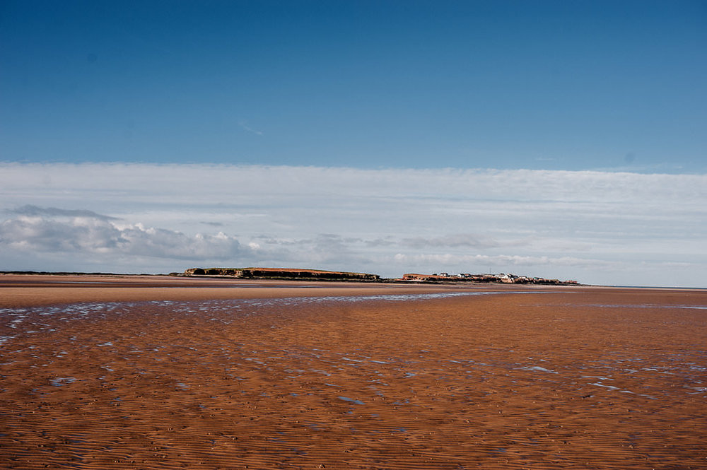 Landscape shot of Hilbre Island in the distance.