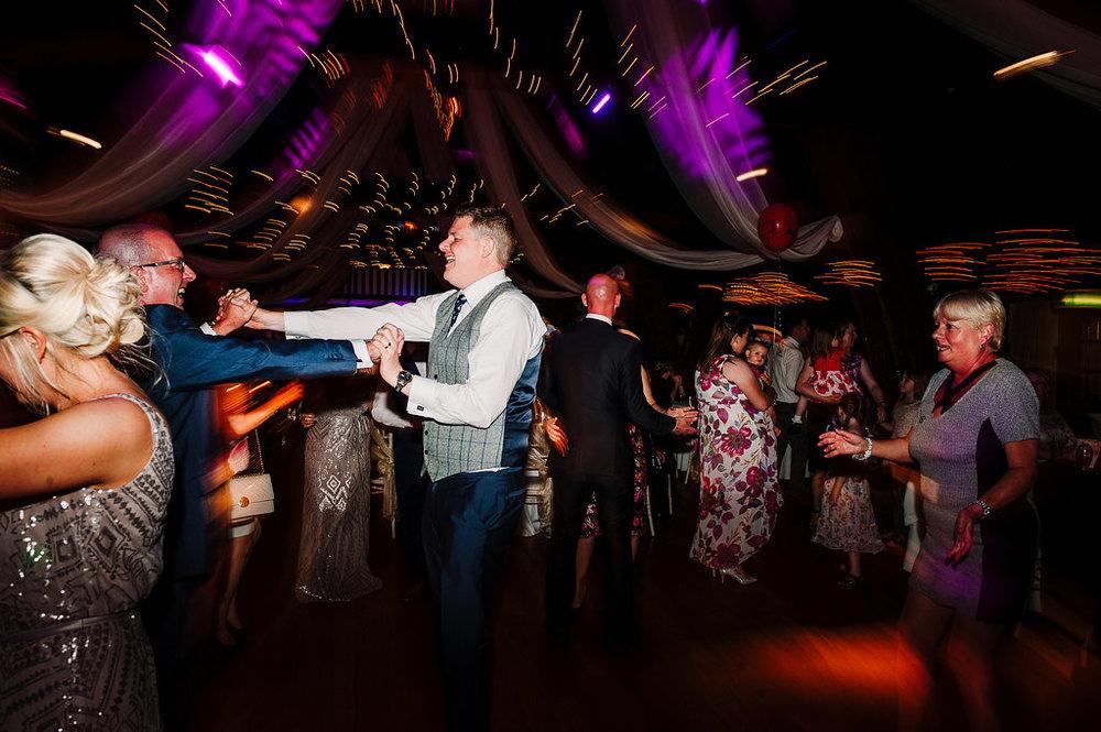 Colourful dance floor shot at Rivington Hall Barn. Bolton Wedding Photography