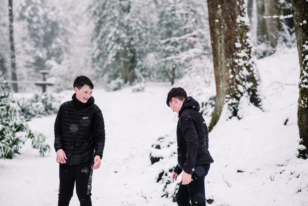 Kids playing in the snow. Lancashire lifestyle photography