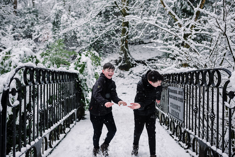 Fun photo of kids playing in the snow. Lancashire photography