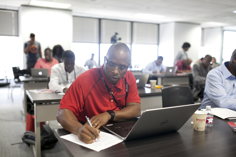 Edward Morgan, Founder of Revitalize Charging Solutions, listens carefully and takes notes during the 2015 PowerUp Bootcamp in New Orleans.