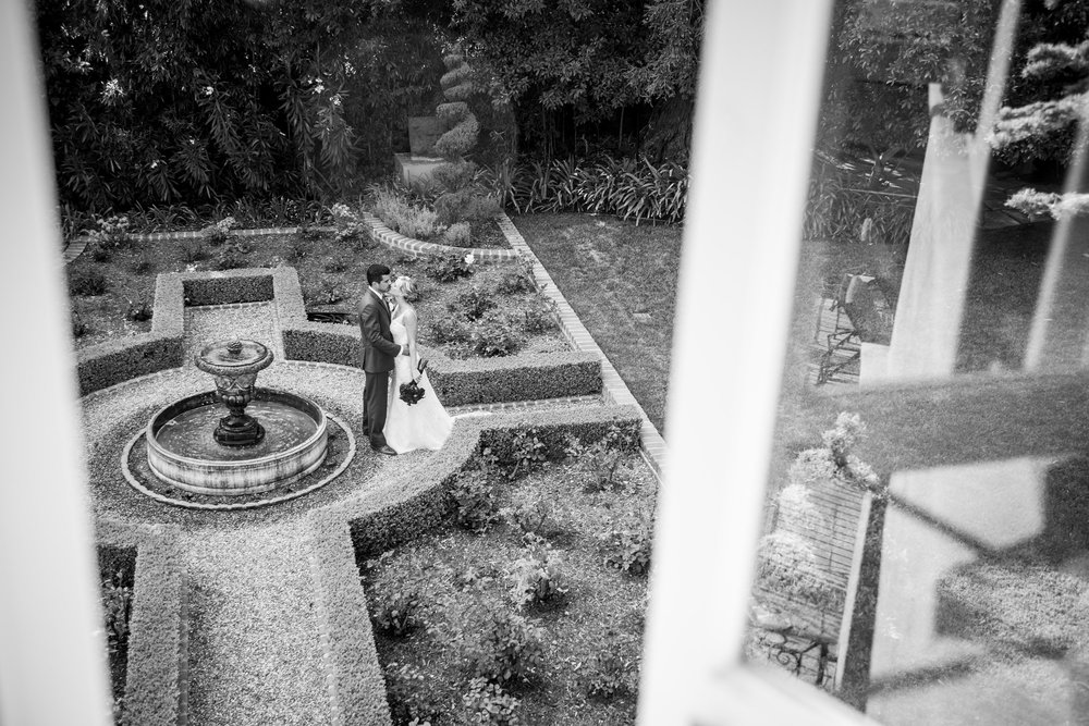 www.santabarbarawedding.com | Bycherry photography | bride and groom kissing in garden black and white