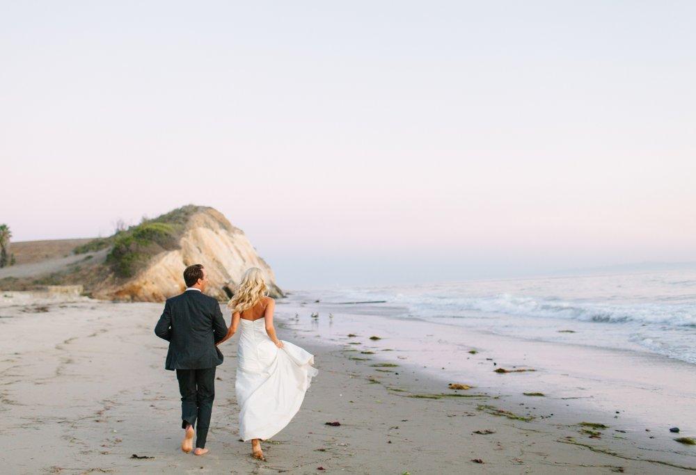 www.santabarbarawedding.com | Dos Pueblos Ranch | Birds of a Feather | Bride and Groom on Beach