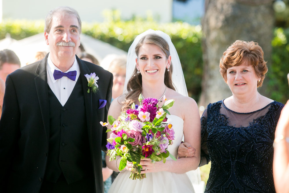 www.santabarbarawedding.com | Philip Van Nostrand | Riviera Mansion | Bride and Parents Walking Down the Aisle