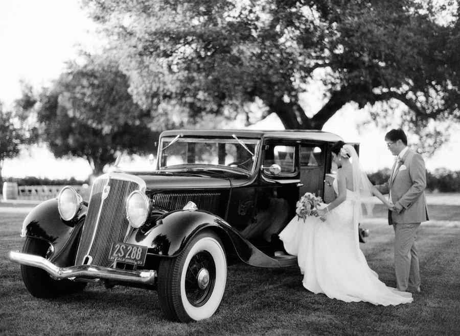 www.santabarbarawedding.com | Firestone Vineyard | Soigne Productions | Michael and Anna Costa | Bride and Groom and Vintage Car