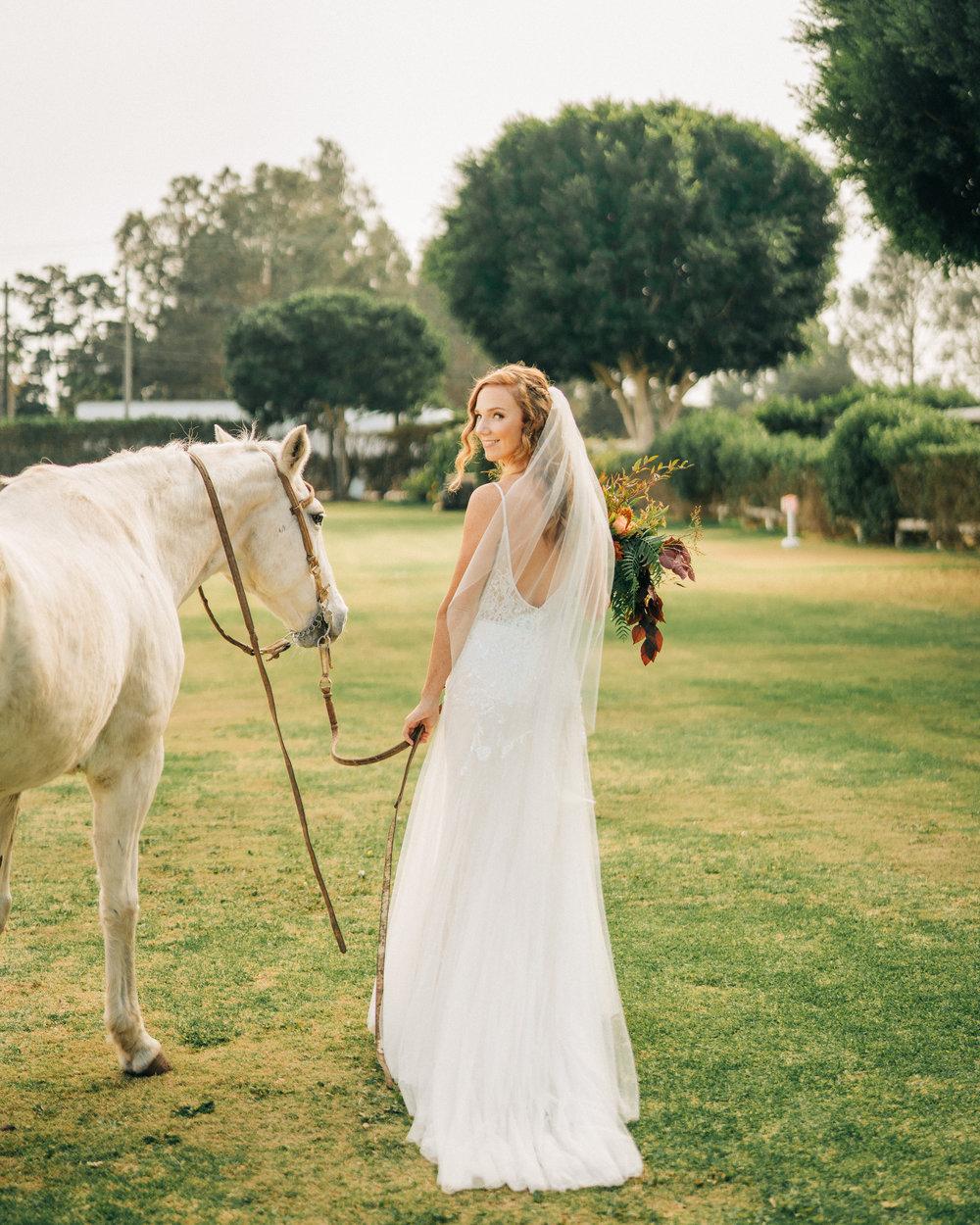 www.santabarbarawedding.com | Brandon Bibbins Photography | The Cottages at Polo Run | Lucy Salgado | Bride Leads Horse