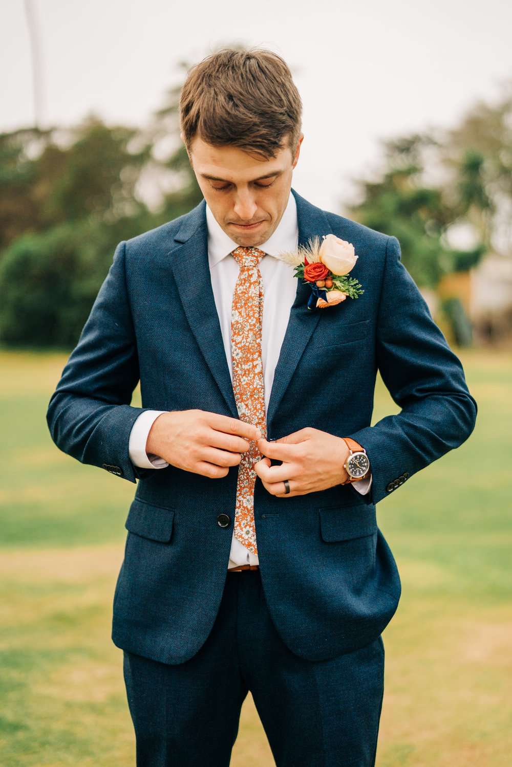 www.santabarbarawedding.com | Brandon Bibbins Photography | The Cottages at Polo Run | Christina Welch Floral | Groom Buttons Up