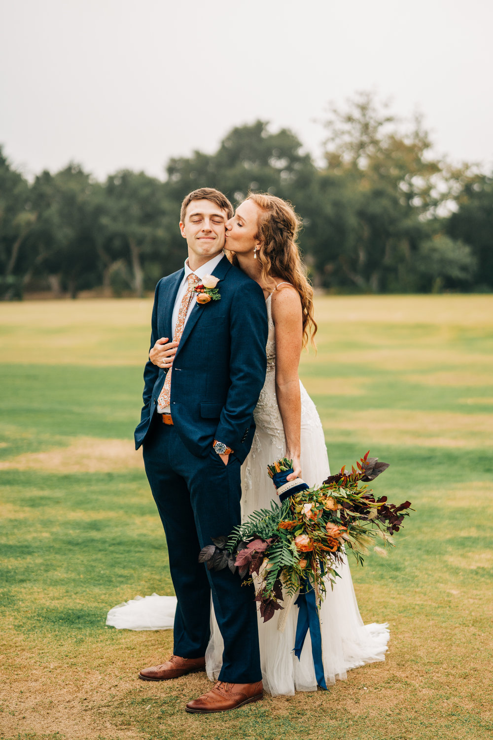 www.santabarbarawedding.com | Brandon Bibbins Photography | The Cottages at Polo Run | Christina Welch Floral | Bride Kisses Groom