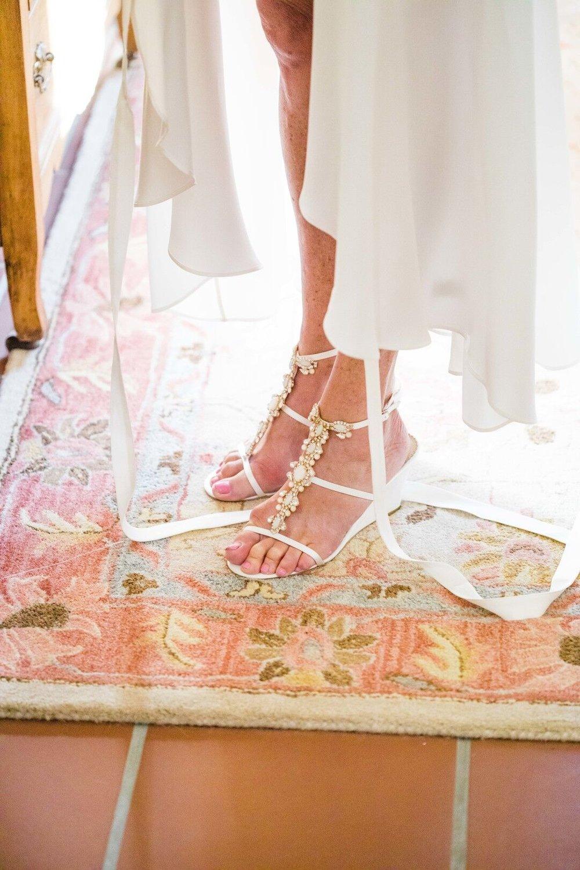 www.santabarbarawedding.com | Venue: Firestone Vineyard | Photographer: Just Kiss Collective | Wedding Dress: BHLDN |  Bridal Shoes