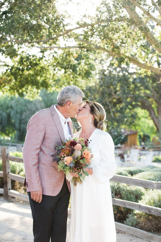www.santabarbarawedding.com | Venue: Firestone Vineyard | Photographer: Just Kiss Collective | Bride and Groom Kiss