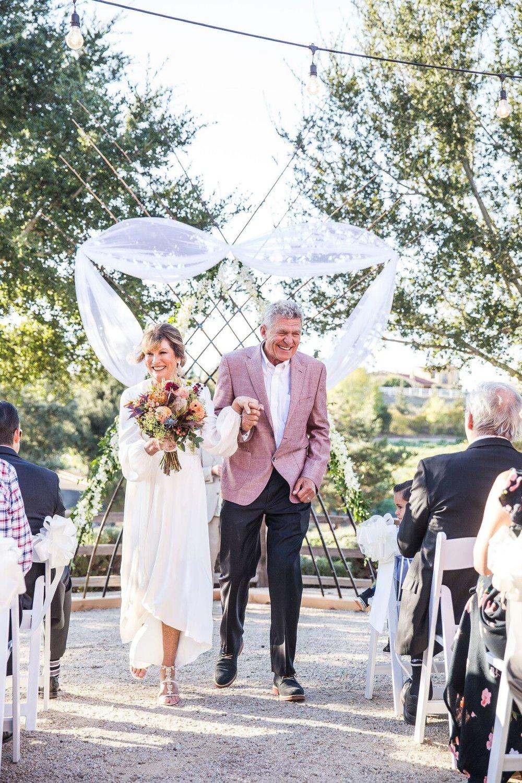 www.santabarbarawedding.com | Venue: Firestone Vineyard | Photographer: Just Kiss Collective | Wedding Dress: BHLDN |  Bride and Groom After Vows