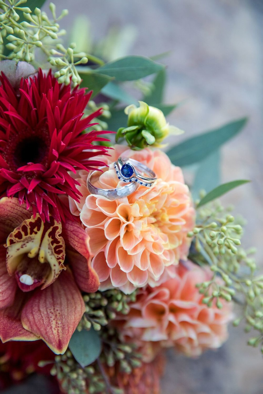 www.santabarbarawedding.com | Venue: Firestone Vineyard | Photographer: Just Kiss Collective | Wedding Rings on Bouquet