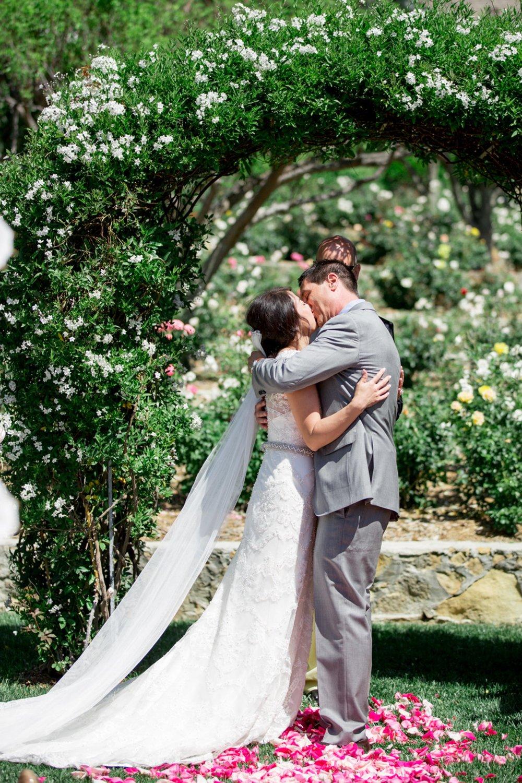 www.santabarbarawedding.com   Michael + Anna Costa Photography   San Ysidro Ranch   Twine Events   The Bride and Groom Share a Kiss