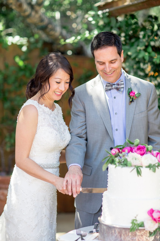 www.santabarbarawedding.com   Michael + Anna Costa Photography   San Ysidro Ranch   Twine Events   Bride and Groom Cut the Cake