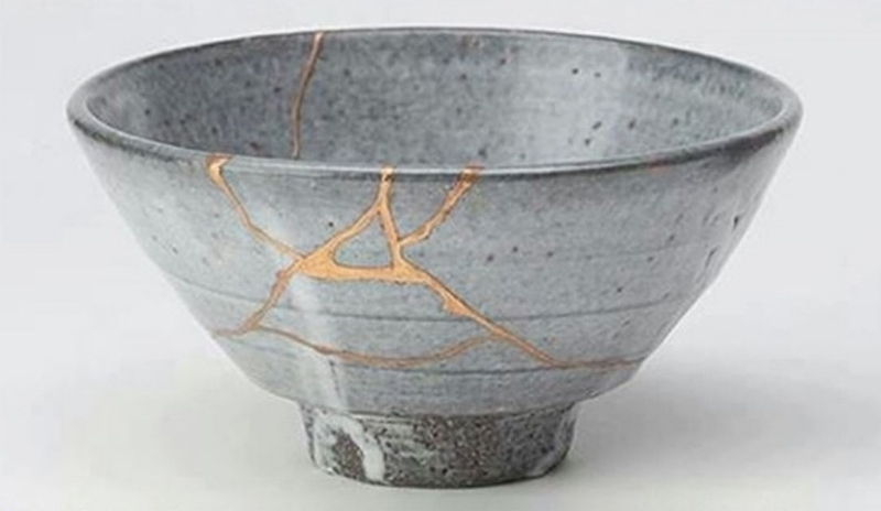 Kintsukuroi:  The art of repairing pottery with gold or silver laquer and understanding that the piece is more beautiful for having been broken.
