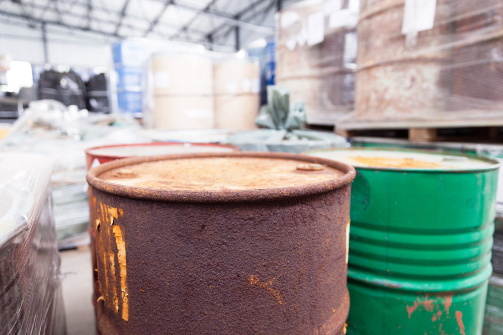 stock-photo-yellow-barrels-with-biohazard-symbol-265880960.jpg