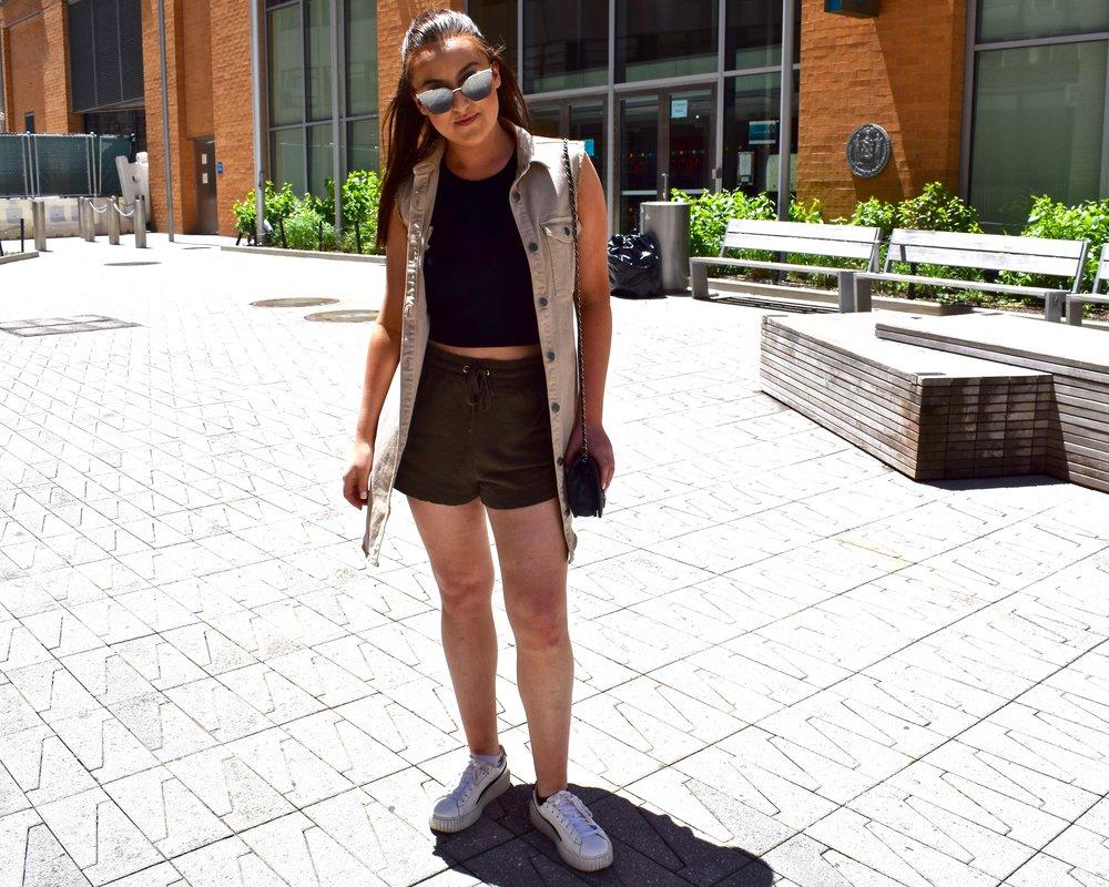 Calvin Klein sleeveless khaki vest  Eliza J halter top  H&M drawstring shorts  Prada reflective cat eye sunglasses  Chanel crossover  Fenty X Puma white leather creeper sneakers
