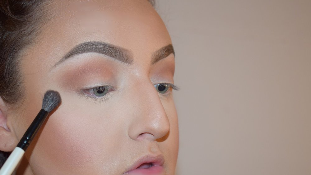 If you have large eyes like me, blend the color outwards towards the end of your eyebrows. You can also place some of the color onto the main part of your lid as I did.  Brush:  Morphe Pointed Bro Blender