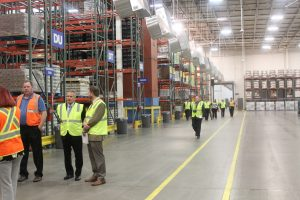 Media and officials touring the Publix Distribution Center in McCalla.