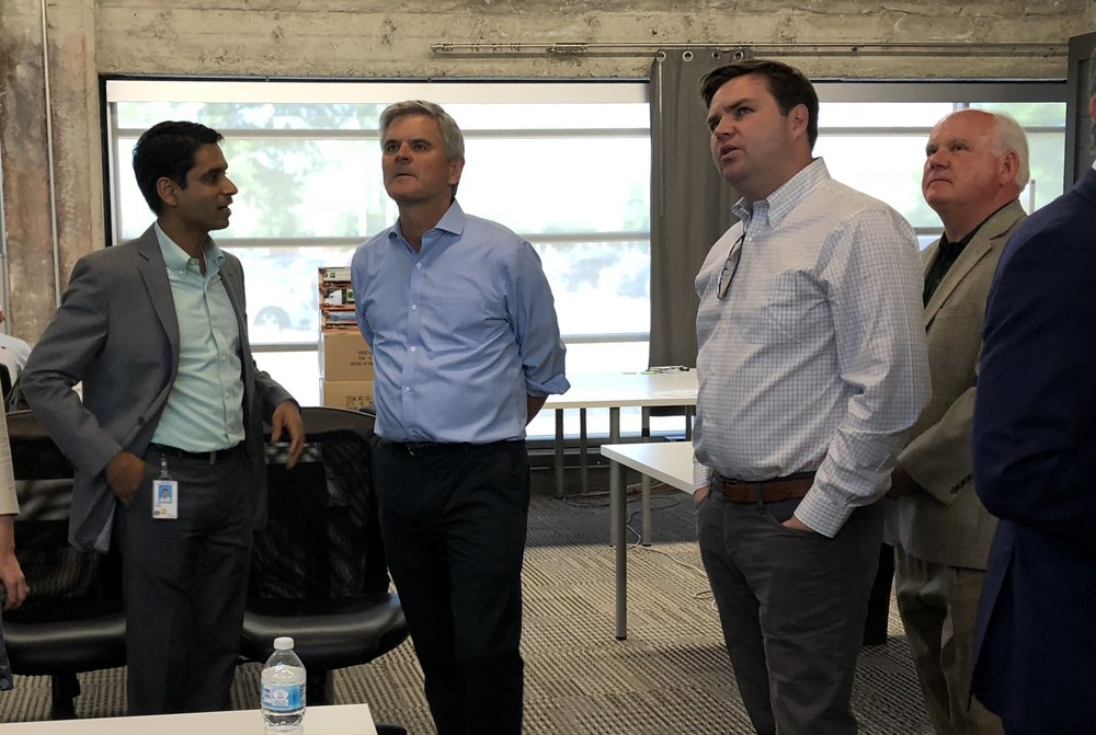 "Dr. Sameer Ather, CEO of Birmingham company XpertDox, meets with, from left to right, Steve Case, J.D. Vance and Dr. Ray Watts during the Rise of the Rest visit in May. Case said Birmingham ""exceeded our expectations."""