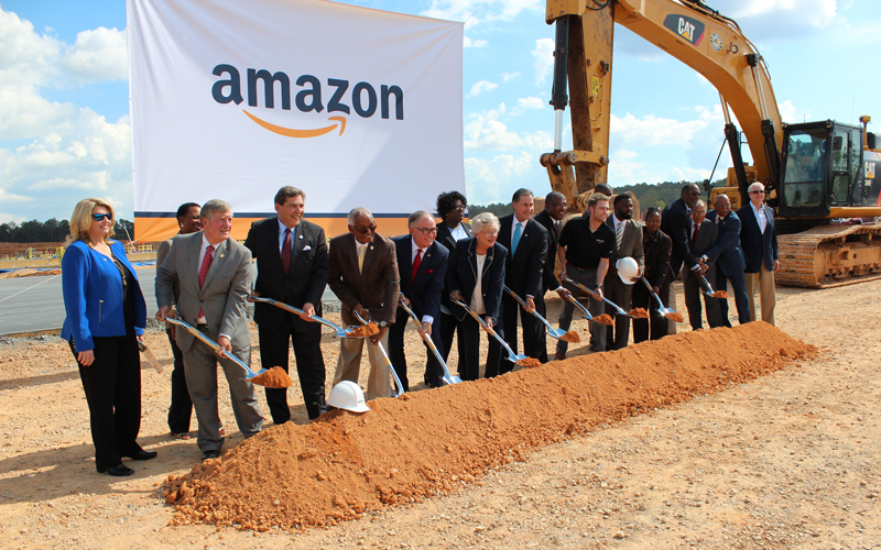 Alabama Governor Kay Ivey, center, stands with partners from the City of Bessemer and Jefferson County to break ground on Amazon's new fulfillment center.