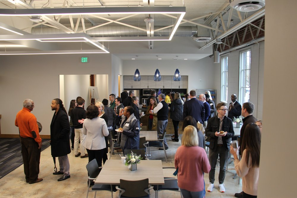 Attendees mingle at the open house for the IT center.