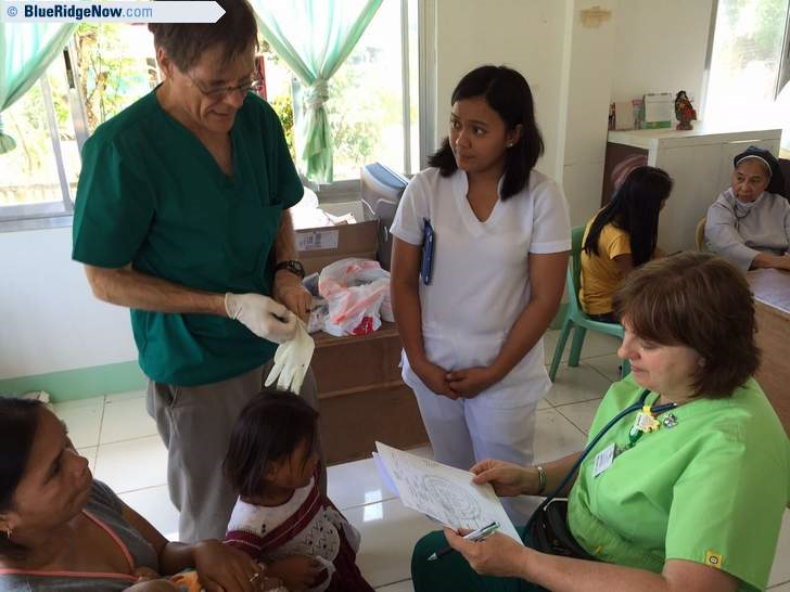 Dr. Paul Krogstad, Elag Adnalro, RN., and Dr. Ann Farash examine a patient at a clinic in the Philippines on a July 2015 medical mission organized by Hendersonville-based nonprofit Florence Nightingale Global Health.