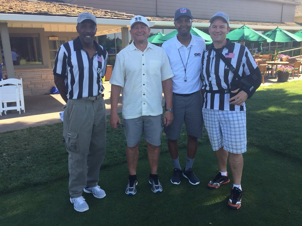 NFL referee Ed Hochuli (second from left) visits with Sacramento area officials.