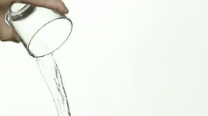 stock-footage-reverse-motion-of-waterbeing-poured-from-glass-against-white-background