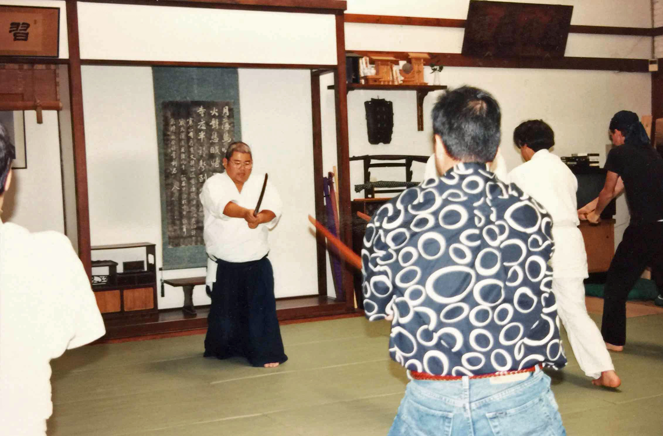 sensei teaching bokken