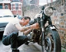 Mechanic Working On Cruiser
