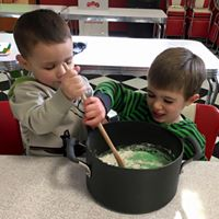 mixing up st. Patrick's day play dough