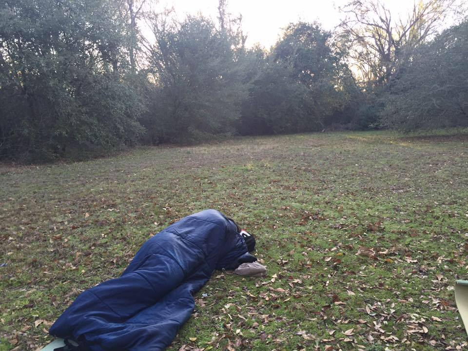 "A picture from a ""microadventure."" My friend, Daniel, and I attended a gala in Bryan, Texas a few years back. Rather than book a room or drive home afterward (which would have amounted to something like 8 hours of driving in one day), we packed sleeping bags and picked a secluded field in which to sleep that night. It was the perfect spot. Trees almost completely encircled us. So even though we were just off the road and a few paces from our cars, we were totally hidden."