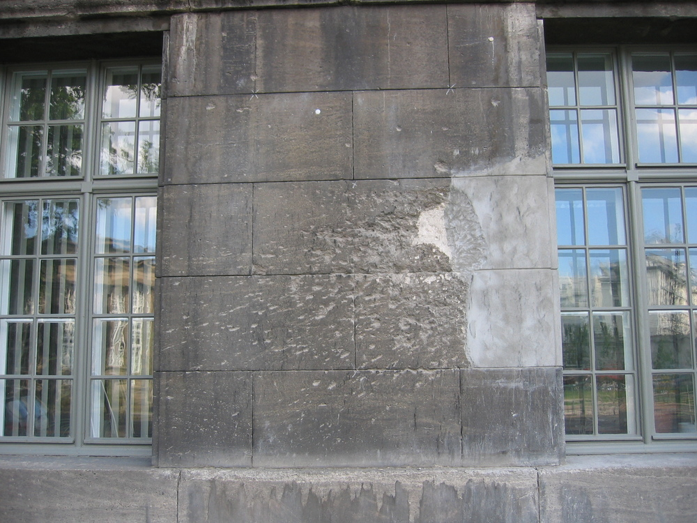 Photograph of the back of the Pergamon Museum Berlin, Germany with tank shell shrapnel spray impact from WW II