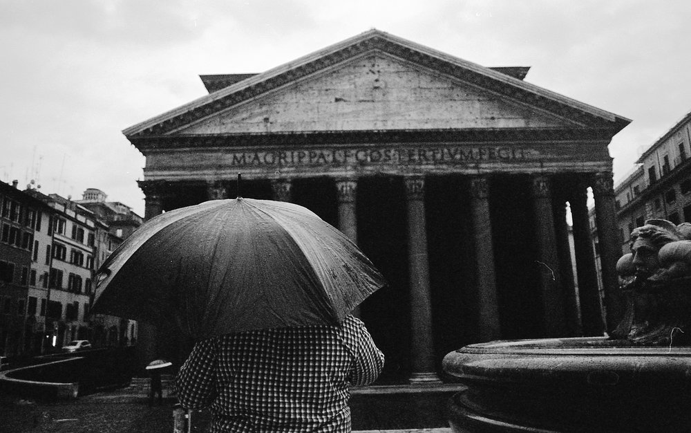 Sometimes when you want a shot that you have envisioned for a long time, you gotta wake up at the crack of dawn, get a couple of Italian espressos in your blood stream, be very patient in the pouring rain, and make it happen! This shot was taken at 7:30am in the morning, at the Pantheon, when no one was around except this guy. CLTV MEMBER - Perry Hall  AKA  Wanderdust Photography  Check out and follow Perry Hall's Instagram  and Facebook  for more upcoming news, events, and of course photos.   Photo licensed and copyrighted ©️ under Wanderdust Photography