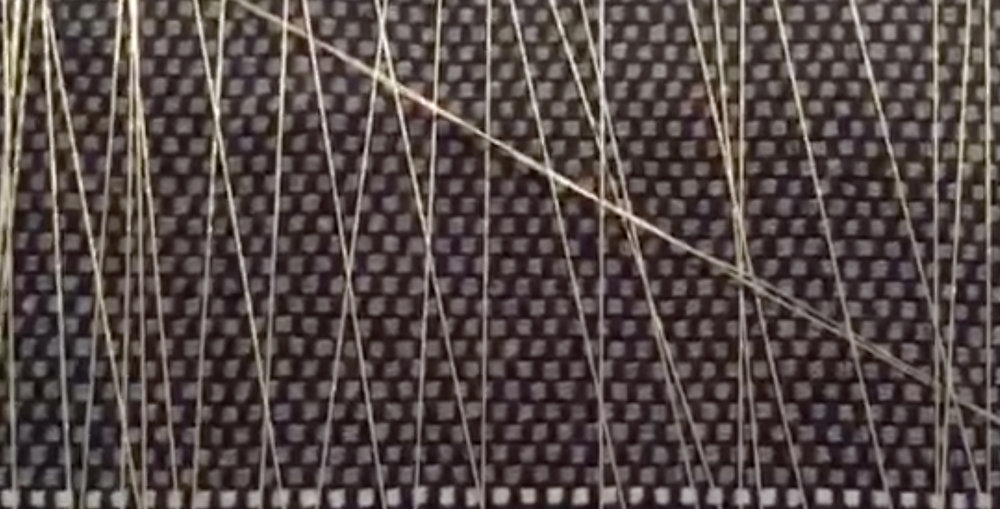 Conductive thread with proximity and touch sensing mapped to bowed marimba sounds.   Watch Video
